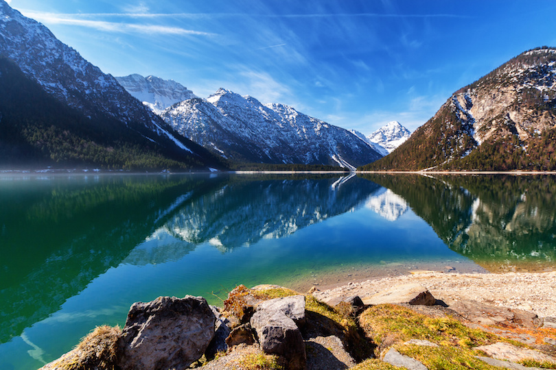 Plansee lake spring panorama with snow on mount top, Tyrol, Austria.
