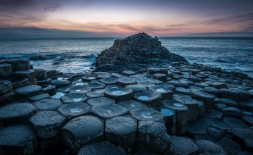 The Giant's Causeway is a unique coastal area of about 40,000 interlocking basalt columns, the result of an ancient volcanic eruption.